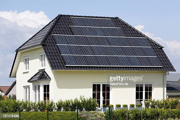 roof of home with solar panels (xxxl) - solar energy dish stock pictures, royalty-free photos & images