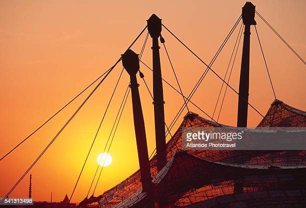 roof of olympic stadium in munich at sunset - olympiastadion munich stock pictures, royalty-free photos & images