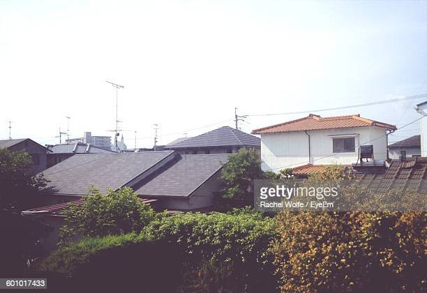 roof of residential buildings against clear sky - rachel wolfe stock pictures, royalty-free photos & images