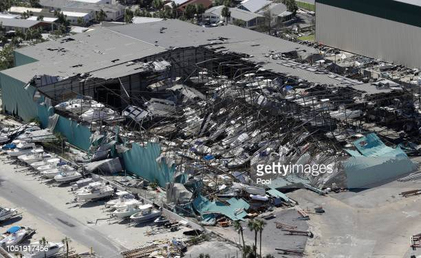 A roof over a boat storage building is collapsed shown in this aerial view on October 11 2018 in Panama City Beach Florida The hurricane hit the...