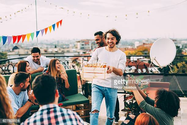 roof party - carrying stock pictures, royalty-free photos & images