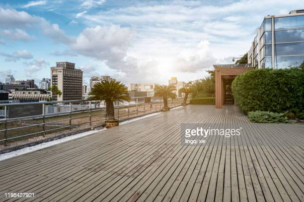 roof terrace of a building in the business district of hangzhou, china - ウッドデッキ ストックフォトと画像