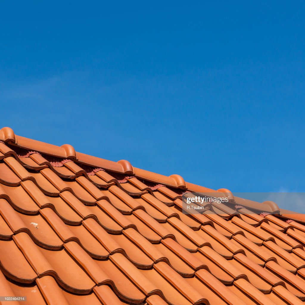 roof tile pattern, close up. Over blue sky : Stock Photo