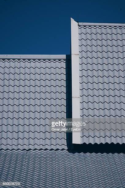 Roof Tiles Of House Against Clear Sky