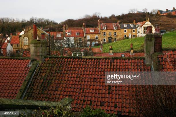 Roof tops and homes in Robin Hood's Bay on the North Yorkshire coast on March 8 2017 in Robin Hood's Bay United Kingdom Robin Hood's Bay is a small...