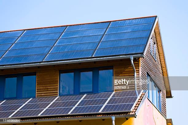 roof with solar panels - solar energy dish stock pictures, royalty-free photos & images