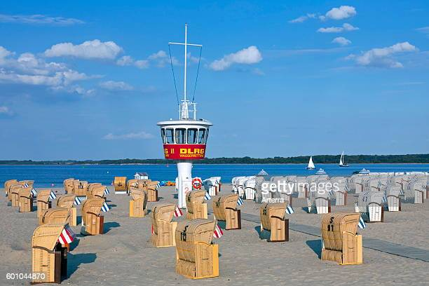 Roofed wicker beach chairs on the beach at Travemuende Luebeck Germany