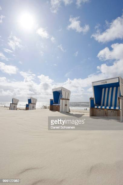 Roofed wicker beach chairs on the beach in Westerland, Sylt island, Schleswig-Holstein, Germany