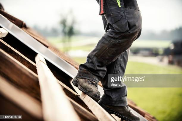 roofer at work - high up stock photos and pictures