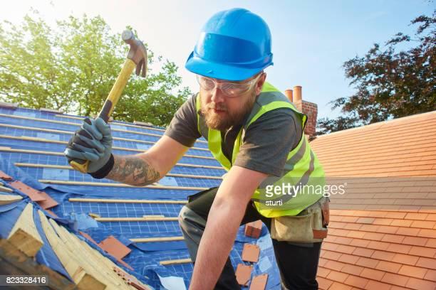 roofer nailing battens