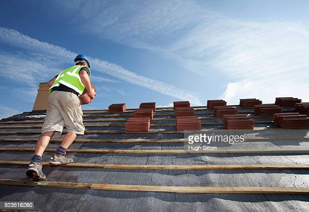 roofer working on construction site - hugh sitton stock pictures, royalty-free photos & images