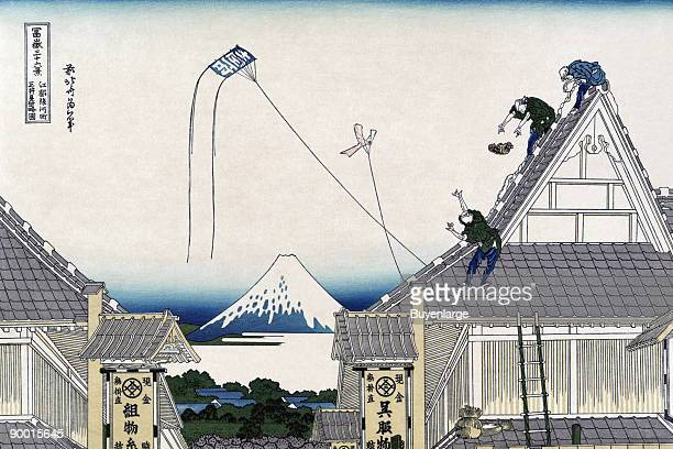 Roofers work on peaked roofs of a building in Edo or Tokyo while kites fly overhead
