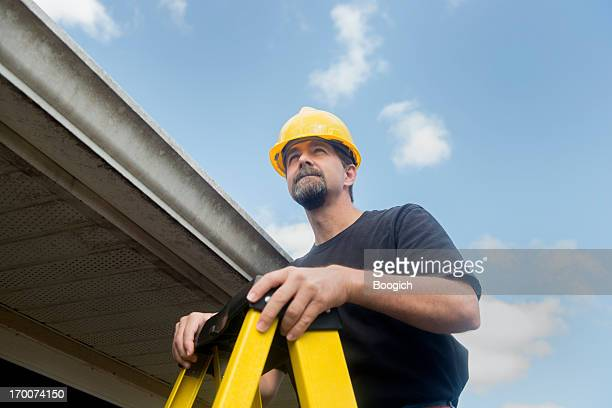 Roofing Contractor Inspects House