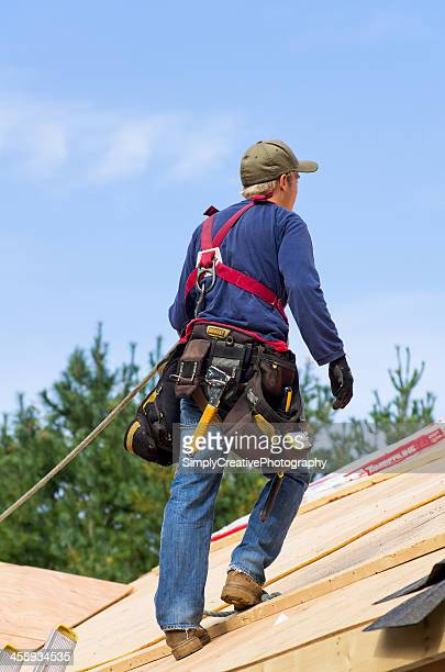 roofing safety equipment - safety harness stock photos and pictures