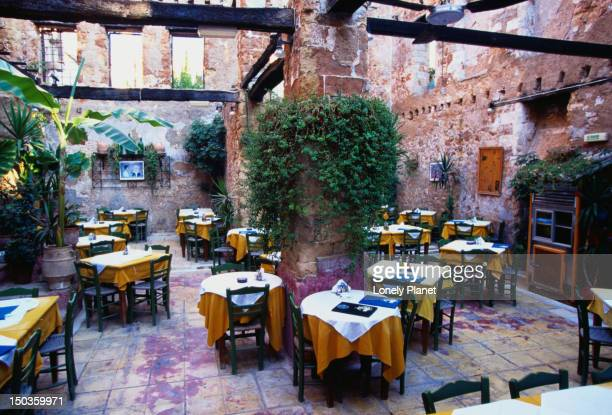 Roofless Restaurant: tables and chairs among the ruins - Hania, Hania Province, Crete