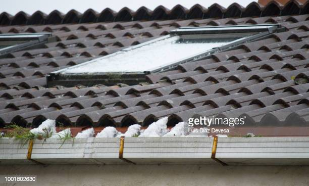 roofs covered with hailstones - 雹 ストックフォトと画像