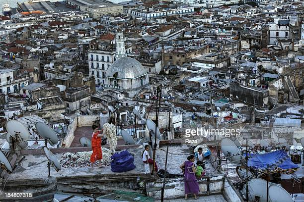 Roofs of the Kasbah a popular neighborhood with a strong population on June 12 in Algiers Algeria During summer mattresses and quilts and wool are...