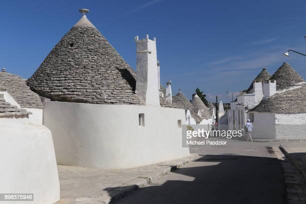 roofs of traditional trulli houses - alberobello stock pictures, royalty-free photos & images