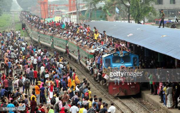 Roofs of trains too get crammed as they reach airport station in Dhaka on Friday 15 June 2018 People continue to streaming out of the capital on...