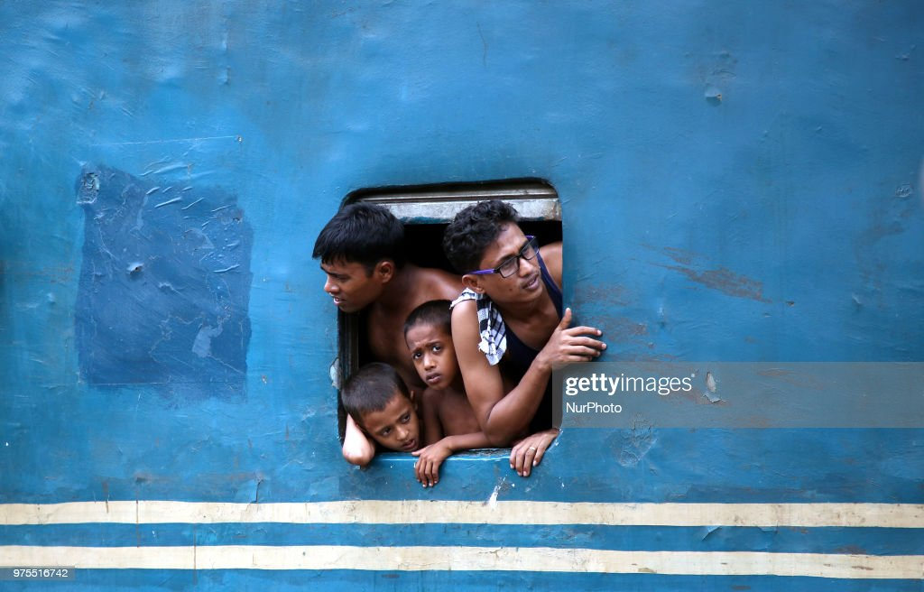 Roofs of trains too get crammed as they reach airport station in Dhaka on Friday, 15 June 2018.Roofs of trains too get crammed as they reach airport station in Dhaka on Friday, 15 June 2018. People continue to streaming out of the capital on Friday to celebrate Eid-ul-Fitr amid shortage of transports, late schedule of trains and excessive fares of tickets.