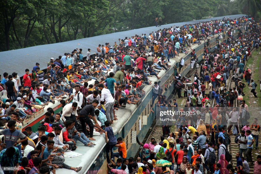Roofs of trains too get crammed as they reach airport station in Dhaka on Friday, 15 June 2018. People continue to streaming out of the capital on Friday to celebrate Eid-ul-Fitr amid shortage of transports, late schedule of trains and excessive fares of tickets.