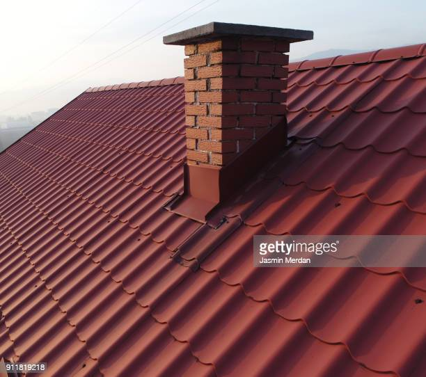 roofs with chimney aerial view - roof stock photos and pictures