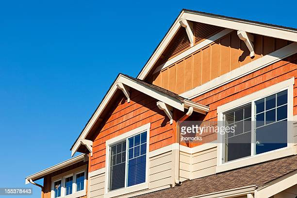 rooftop against clear blue sky - eaves stock photos and pictures