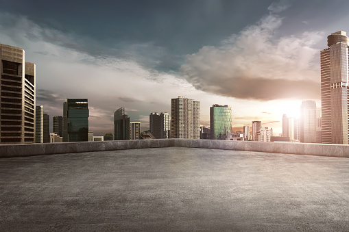 Rooftop balcony with cityscape 931040500