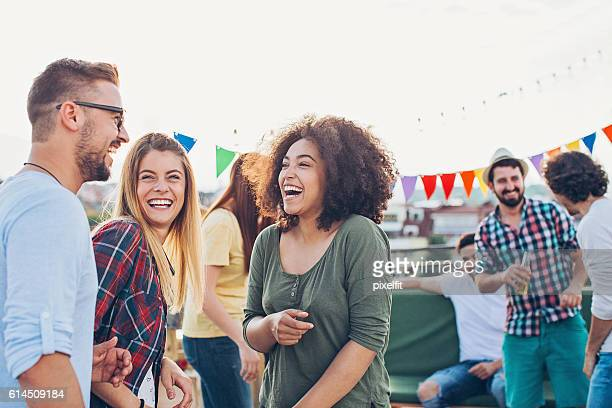 rooftop celebration - outdoor party stock pictures, royalty-free photos & images