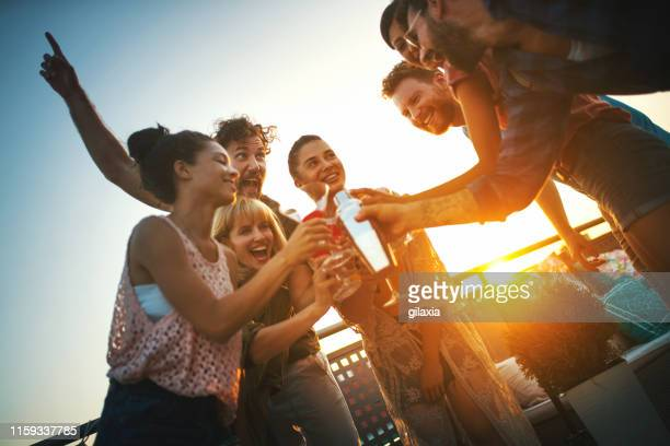 rooftop cocktail party - cocktail party stock pictures, royalty-free photos & images