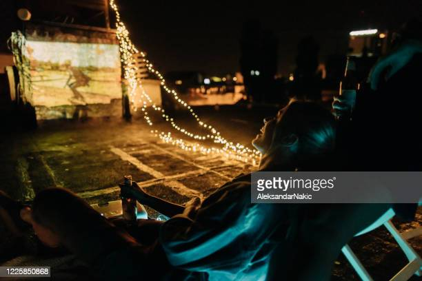 rooftop movie nights - night in stock pictures, royalty-free photos & images