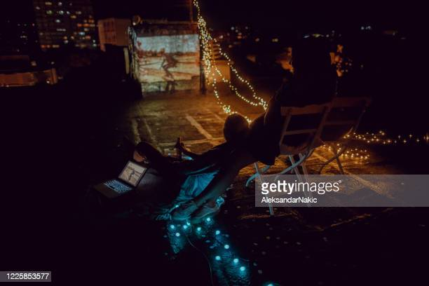 rooftop movie nights with my girlfriends - night in stock pictures, royalty-free photos & images