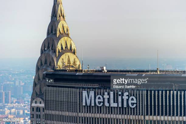 Rooftop of the Chrysler Building over Brooklyn with top stories of MetLife Building in foreground
