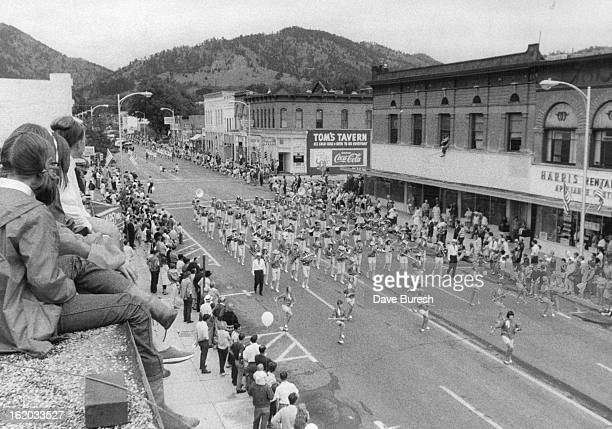 JUL 27 1968 JUL 28 1968 Rooftop or Pearl street provides panoramic Vantage point for several girls as pikes peak booster band passes below The...
