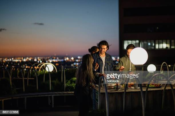 rooftop party after dark - melbourne australia stock pictures, royalty-free photos & images