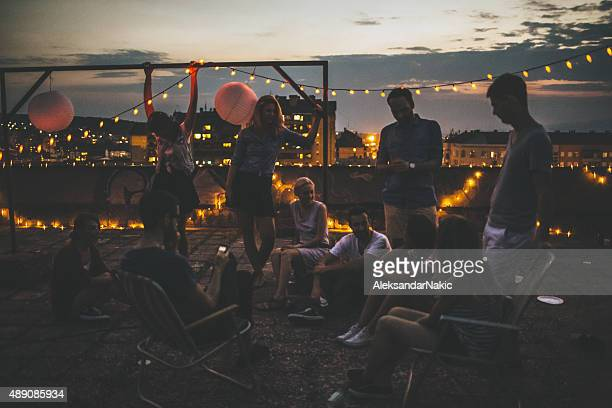 rooftop party moments - roof stock photos and pictures