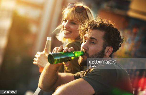 rooftop party on a summer afternoon. - human body part stock pictures, royalty-free photos & images