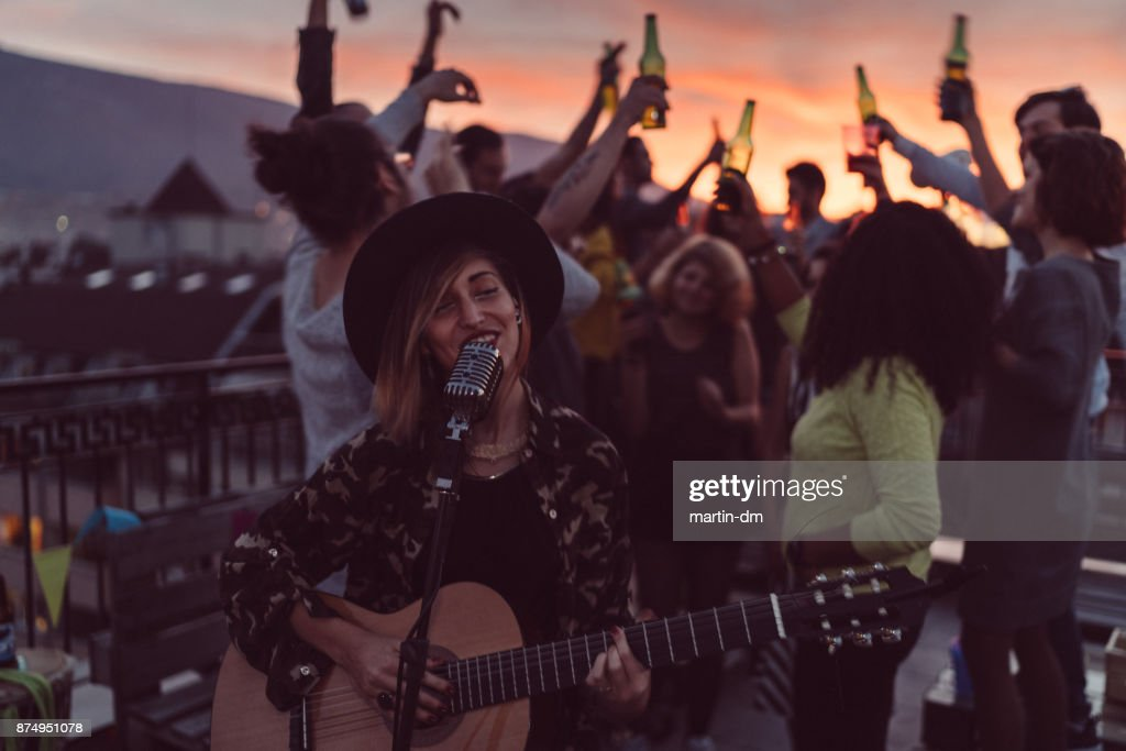 Rooftop party with solo performance : Stock Photo