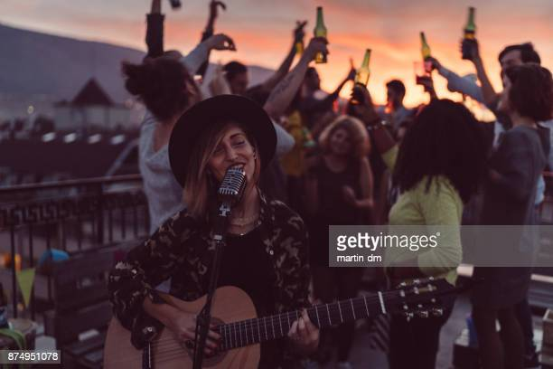 Rooftop party with solo performance