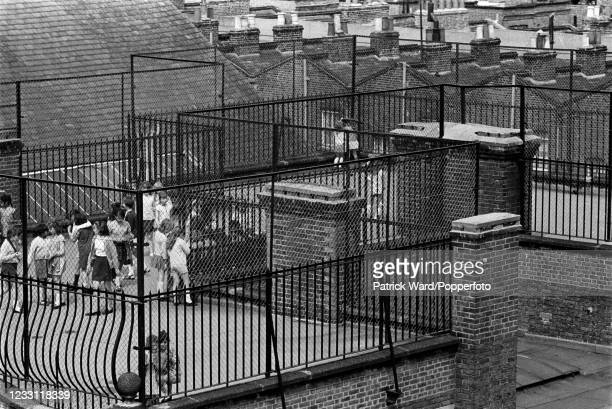 Rooftop playground at a Junior School in Notting Hill, London, circa June 1969. From a series of images to illustrate the many frustrations of living...