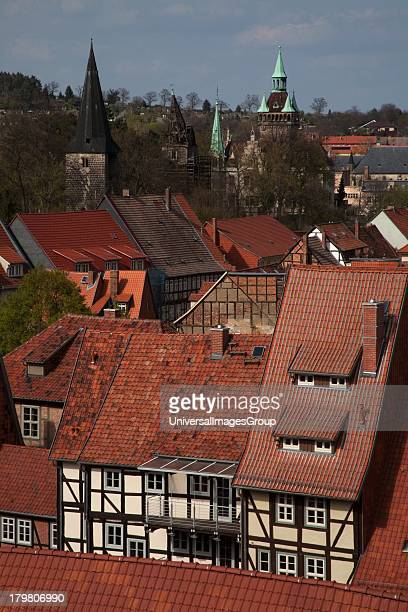 Rooftop view of relic halftimbered skyline buildings atop Castle Hill in 1000 old Quedlinburg Germany a UNESCO World Heritage Site