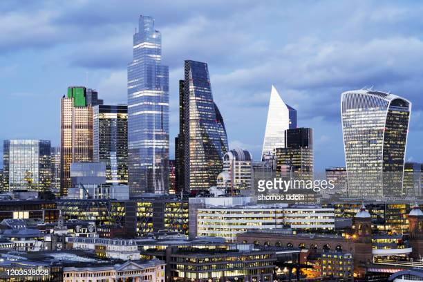 rooftop view over london financial district at dusk - dusk stock pictures, royalty-free photos & images