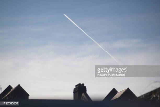 rooftops and pastel blue sky - howard pugh stock pictures, royalty-free photos & images