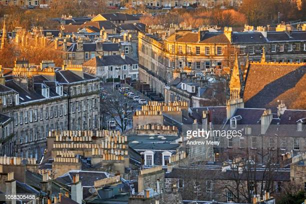 rooftops and rows of houses at sunset, new town, edinburgh - edinburgh scotland stock photos and pictures