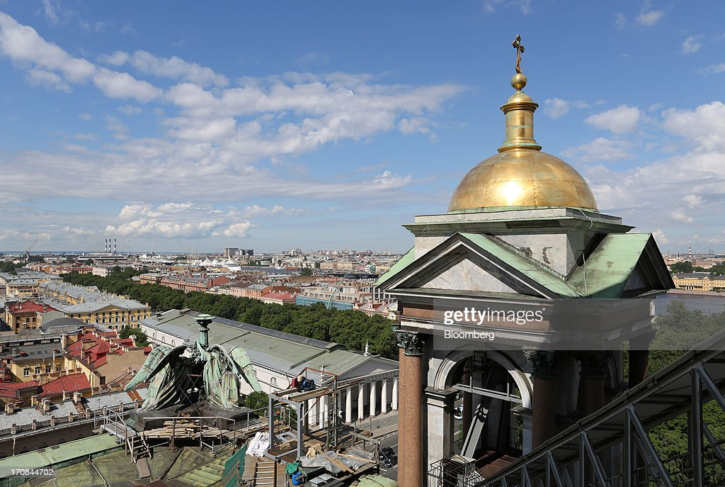 Rooftops and the waterfront are seen from St. Isaac's cathedral ahead of the St. Petersburg International Economic Forum 2013 (SPIEF) in St. Petersburg, Russia, on Wednesday, June 19, 2013. The Russian Deputy Prime Minister Igor Shuvalov told the conference that the country's World Trade Organization accession negotiations could be further delayed unless several remaining disputed matters are solved. Photographer: Andrey Rudakov/Bloomberg via Getty Images