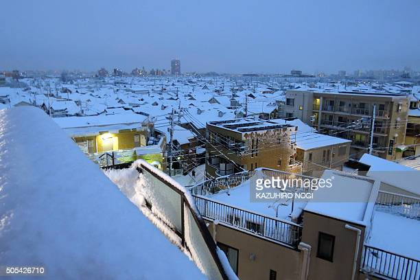 Rooftops are covered with snow early morning in Tokyo on January 18 2016 Tokyo had its first snow of the season amid cold temperatures with snowfall...