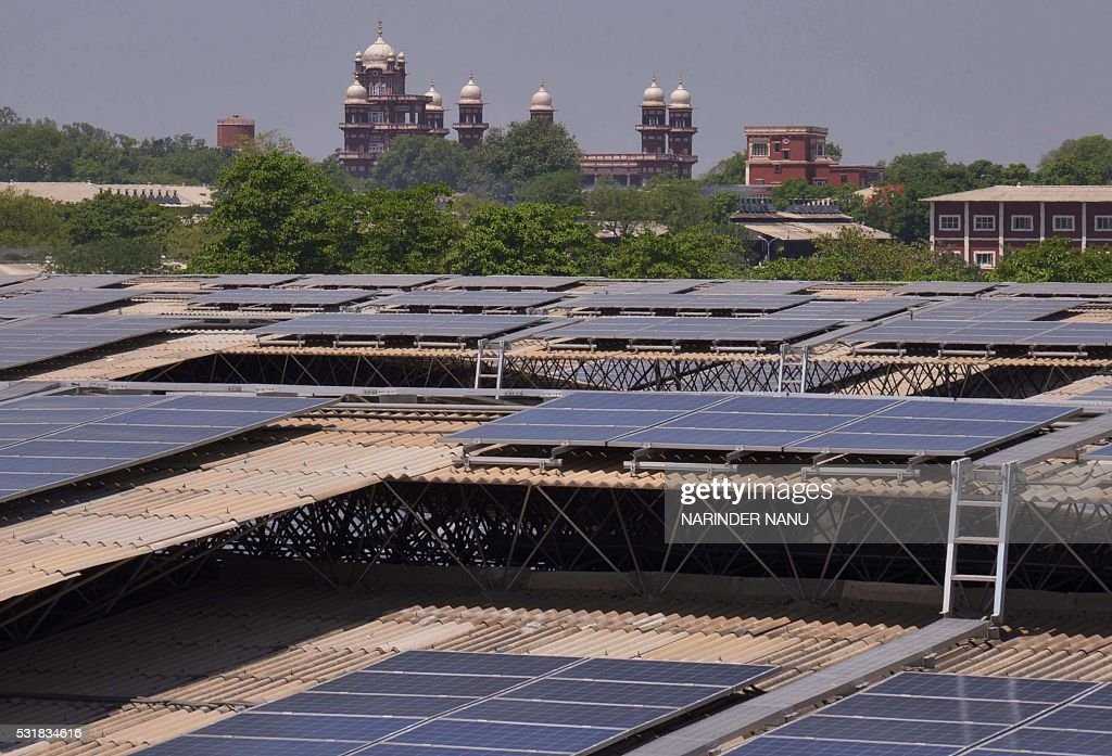 Rooftops covered in solar panels are seen at the Indian Solar Photovoltaic Power Plant some 45kms from Amritsar on May 17 2016 Spread over eight...