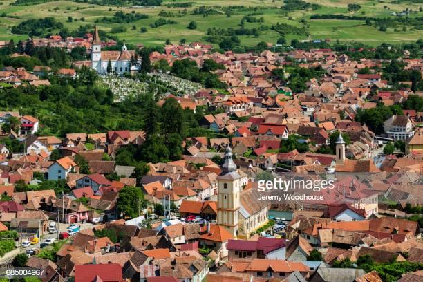 rooftops in cityscape, rasinari, transylvania, romania - sibiu stock-fotos und bilder
