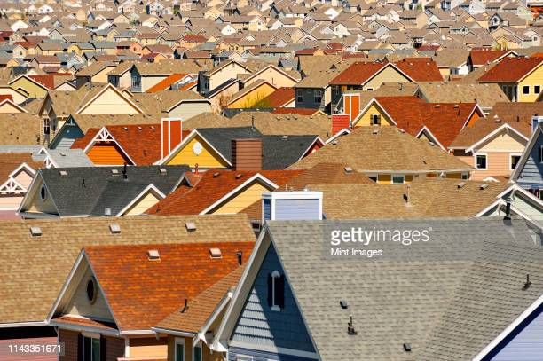 rooftops in suburban development, colorado springs, colorado, united states - housing development stock pictures, royalty-free photos & images