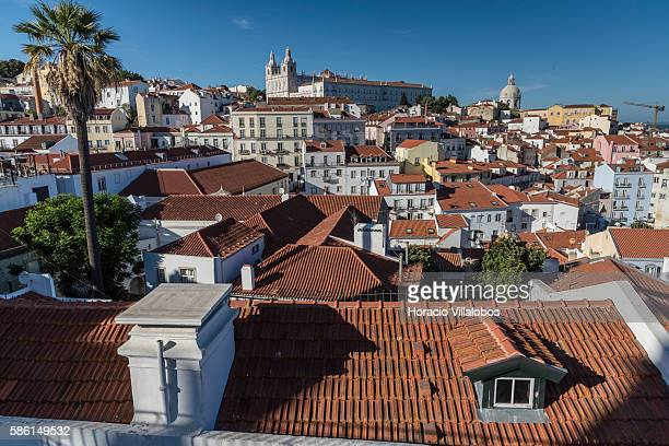 Rooftops of Alfama one of the city's historic neighborhoods on August 03 2016 in Lisbon Portugal The large influx of tourists to this historic areas...